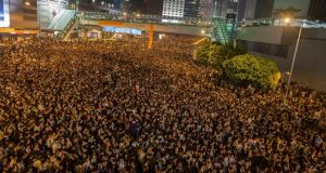 Pro-democracy protesters gather outside the Hong Kong government headquarters. Photograph: Alex Hofford/EPA