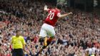 Manchester United's Robin van Persie celebrates after scoring a goal against West Ham United. He believes that United's strikers can instil fear in the opposition. Photograph:  Darren Staples/Rueters