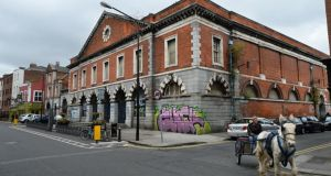 The graffitied exterior of  the Iveagh Markets on Dublin's Francis Street. Photograph: Dara Mac Dónaill