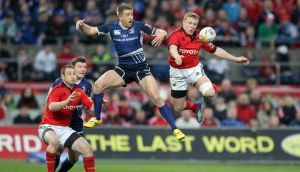 Munster's Keith Earls (right) will be out for up to four months. Photograph: Dan Sheridan
