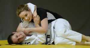 Laura Kennedy takes on Suzanne Roche in Brazilian jiu-jitsu at SBG, Dublin. Photograph: Dara Mac Dónaill