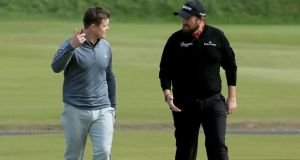 Former Ireland rugby captain Brian O'Driscoll talks with Shane Lowry  on the first hole during the final practice round prior to the 2014 Alfred Dunhill Links Championship at The Old Course  at St Andrews . Photograph:  David Cannon/Getty Images