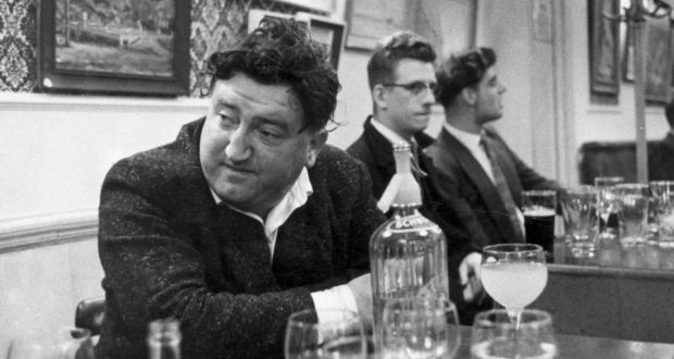 Irish playwright and author Brendan Behan drinking at the Fitzroy Tavern, London. Photograph: Haywood Magee/Picture Post/Getty Images