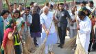 India's prime minister Narendra Modi (centre) helps to clean a road in New Delhi yesterday as part of his campaign   campaign  to promote cleanliness and better sanitation in the country. Photograph: EPA/Indian Press Information Bureau