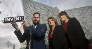 Celebrating the Invent 2014 awards are winner Sean McAllister of Plotbox, awards sponsor, Julie Ann O'Hare, director of Business Banking, at Bank of Ireland UK and Leona McAllister of Plotbox.