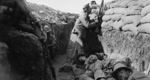 Gallipoli –  Royal Irish Fusilier attempts to draw fire of a Turkish sniper. Photograph: Lieut Ernest Brooks/ IWM via Getty Images