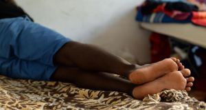 At rest: A young asylum seeker at the Green School emergency acccommodation centre in Augusta, Sicily. Photograph: Frank Miller