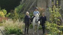 Rider Jamie O'Brien with therapeutic riding coaches Arina Jozwik and Rachel Ardagh as they follow Festina Lente's new therapy trail past a border designed by Oliver Schurmann. Photograph: Richard Johnston