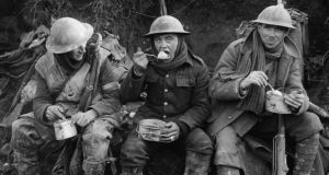 British soldiers eating hot rations in the Ancre Valley during the Battle of the Somme, October 1916. Photograph: Lt E Brooks/ IWM via Getty Images