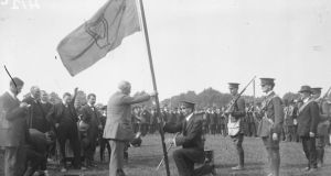 John Redmond presents a flag to the Irish Volunteers. And recruitments posters for the British Army. Courtesy, National Library of Ireland
