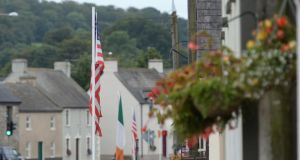 The American flags are still flying on Main Street. Photograph: Dara Mac Dónaill