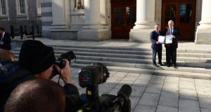 'A closer look at the Exchequer data, however, as well as the lessons learned from our recent experience with boom-and-bust, would caution against prematurely bringing to a halt efforts to restore order to the public finances.' Above, Minister for Finance Michael Noonan and Minister for Public Expenditure and Reform  Brendan Howlin  at Government Buildings before delivering the Budget 2014 to the House. Photograph: Bryan O'Brien / THE IRISH TIMES