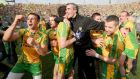 Former Donegal manager Jim McGuinness celebrates with his players after winning the Sam Maguire in 2012. Photograph: Inpho