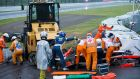 Medical staff treat French driver  Jules Bianchi after his car slid off the track and crashed in wet conditions at the Japanese Grand Prix at Suzuka. The Marussia driver was later airlifted to hospital and is reported to be in a serious condition.  Photograph: Hiroshi Yamamura/EPA