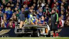 Fergus McFadden leaves the field on a stretcher after injuring his ankle in the Guinness Pro12 game against Munster at the Aviva Stadium. Photograph: James Crombie/Inpho