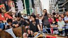 Pro-democracy protesters gathered at a barricade in the Mong Kok area of Hong Kong. Photograph: Adam Ferguson/The New York Times