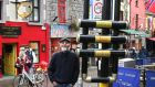 Tommy Lennon with his creation of a giant-size trumpet at Galway's Cross Street yesterday. Photograph: Joe O'Shaughnessy