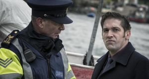 A still from the Irish-language film An Brontannas, directed by Tom Collins, which has been submitted in the foreign language category of the Oscars. The image shows John Finn as Garda Sean Óg, with Owen McDonnell as Fiachra Green. Photograph: IFTA