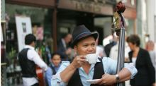 The band Manila Strings enjoy coffee outside Bewley's on Grafton Street, Dublin. Photograph: Bryan O'Brien