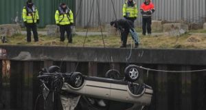 A car involved in the incident being removed from the water at Arklow harbour in March 2013. Photograph: Niall Carson/PA Wire