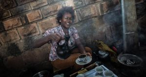 Stall: a street trader pours coffee, Ethiopia's main export. Photograph: Anthony Pappone/Moment/Getty