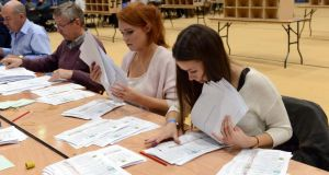 Counting gets under way in the Dublin South West by-election as boxes are opened at the National Basketball Arena in Tallaght this morning. Photograph: Eric Luke / The Irish Times.