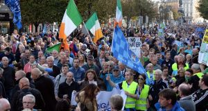 People taking part in the anti-water charges protest march today. Photograph: Eric Luke / The Irish Times