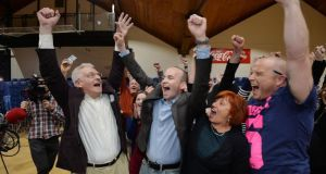 Paul Murphy (second left) of the Anti Austerity campaigner celebrates winning the Dublin South West byelection at the National Basketbal Arena in Tallaght. Photograph: Alan Betson/The Irish Times.