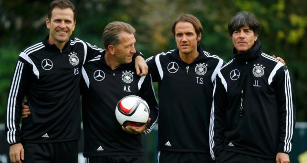 German national team coach Joachim Löw (right) with (from left) general manager Oliver Bierhoff, goalkeeper coach Andreas Koepke and coach assistant Thomas Schneider. Photograph: Kai Pfaffenbach/Reuters.