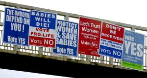 Referendum posters on a pedestrian bridge in Dublin in 2002.