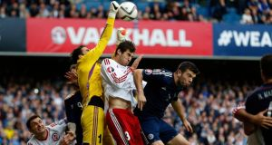 Scotland's Grant Hanley (right) is out of the game against Poland. Photograph: Russell Cheyne/Reuters