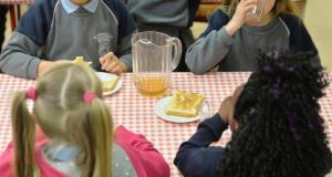 Eating breakfast at  St Patrick's School's Breakfast Club. Photograph: Alan Betson