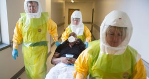 Staff at the Royal Victoria Infirmary hospital in Newcastle, England take part in a   national exercise to test Britain's readiness for an Ebola outbreak. Photograph: PA