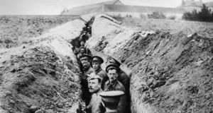 British soldiers lined up in a narrow trench in the early days of the war. Photograph: Hulton Archive/Getty Images