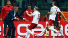 Poland's Sebastian Mila (centre) celebrates with coach Adam Nawalka (left) after scoring against Germany  at the National Stadium in Warsaw on Saturday. Photograph: Kacper Pempel / Reuters