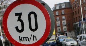 Cutting speed limits in urban areas to 30 km/h (20 mph) reduces the number of road accidents . Photograph: Gareth Chaney/Collins