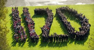 To celebrate  maths week 2014,  pupils from the Dunboyne Junior and Senior Primary Schools join together to make 1120, the total number of pupils attending the schools, in Co Meath. Photograph: Alan Betson