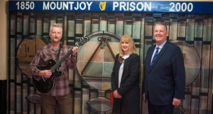 Billy Bragg; Deborah Blacoe, Philip Chevron's sister; and Mountjoy campus governor Brian Murphy pictured as Chevron's guitars were donated to Mountjoy Prison.  Photograph: Aidan Oliver