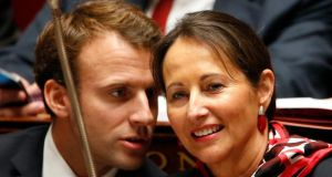 Economy minister Emmanuel Macron speaking with ecology minister Ségolène Royal, who had caved in to pressure from lorry drivers. Photograph:  Charles Platiau/Reuters