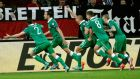 John O'Shea races away in celebration with his teammates after scoring the Republic of Ireland's equaliser at Arena Auf Schalke in Gelsenkirchen, Germany. Photograph: EPA