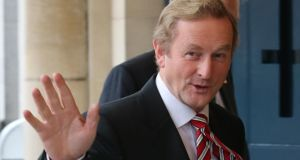 Taoiseach Enda Kenny: said there area 410,000 people on low incomes whose earnings are now better off under this Government than the last. Photograph:  Niall Carson/PA Wire