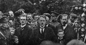 De Valera in mind: WT Cosgrave at Arthur Griffith's funeral, in August 1922; Michael Collins is in the background. Photograph: Daily Sketch/Hulton/Getty