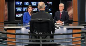 Talking politics: Alison Lundergan Grimes with Mitch McConnell before their TV debate. Photograph: Pablo Alcala/Reuters