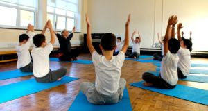Students at Francis St CBS boys primary school in the Liberties, Dublin, take part in a yoga class. Photograph: Ashoka Ireland