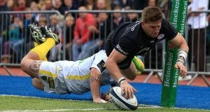 Saracens' David Strettle dives over for a try during the European Rugby Champions Cup match against Clermont at Allianz Park, London. Photograph:  Mike Egerton/PA Wire