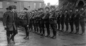 Minister for defence Gen Richard Mulcahy inspects Free State soldiers at Dublin Barracks after Partition in 1922. Photograph: Walshe/Topical Press Agency/Getty Images