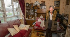 A file image from last week of Nellie Halligan, grandmother of the injured children, in the   living room where a petrol bomb was thrown through a window. Photograph: Patrick Browne
