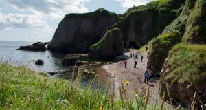 Tourist's take a look around the Caves in Cushendun , Co Antrim while on the Game of Thrones tour. Photograph: Mark Marlow/pacemaker press