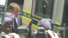 Oscar Pistorius leaves the Pretoria court that sentenced him to five years in jail for the killing of his former girlfriend Reeva Steenkamp in an armoured police vehicle. Video: Reuters