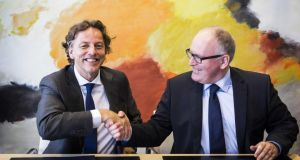 The Netherlands outgoing foreign minister Frans Timmermans (right) transfers his duties to Bert Koenders at the foreign ministry in The Hague on October 17th.  Photograph: Valerie Kuypers/ EPA